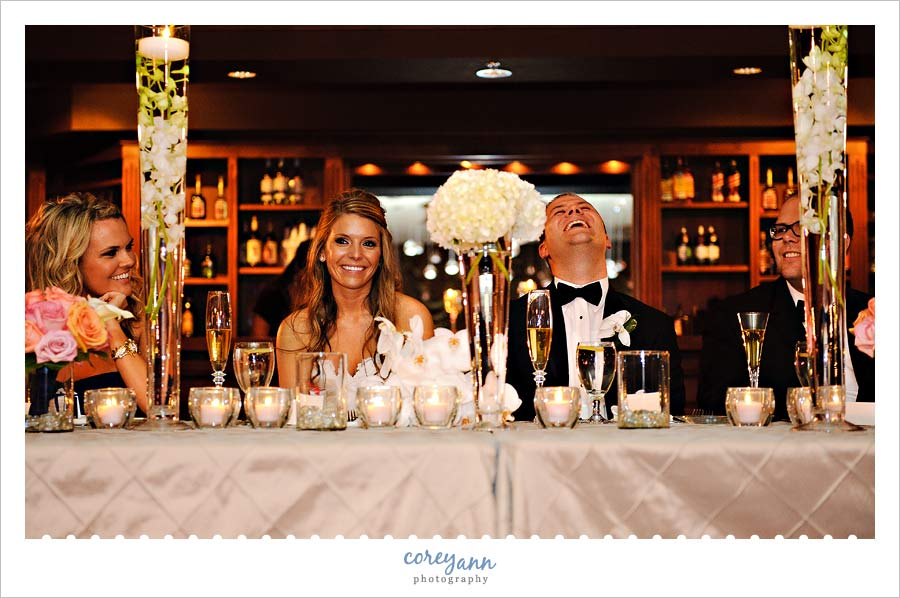 bride and groom laughing during toasts in sharon pa
