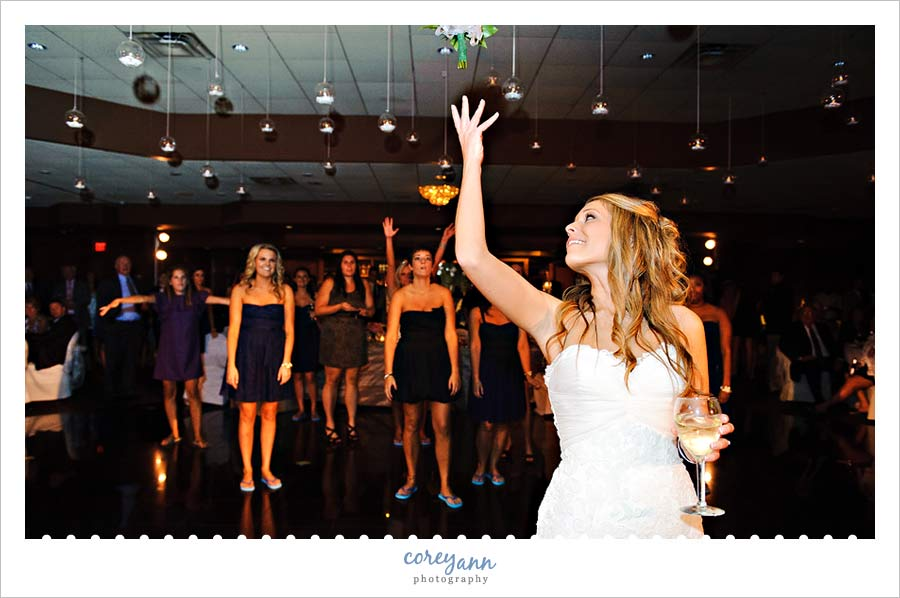 bouquet toss at reception at buhl park at avalon lakes