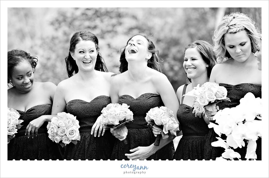 bridesmaids laughing during wedding pictures