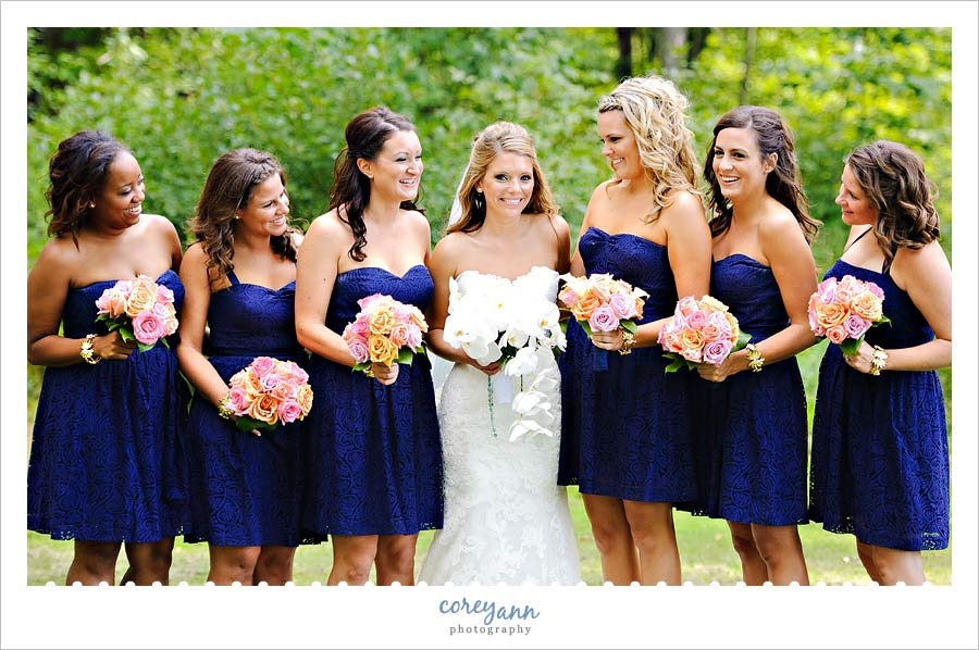 bridesmaids in blue dresses at buhl park at avalon lakes country club