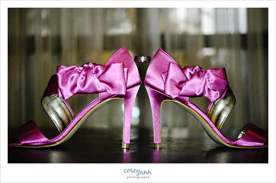 wedding ring balanced on pink high heels