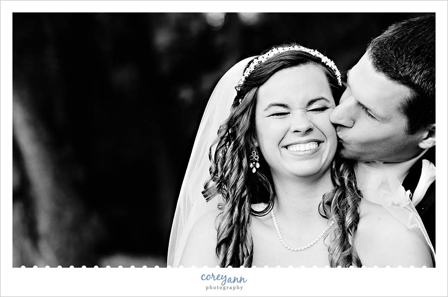 bride laughing during portraits at mckinley monument park
