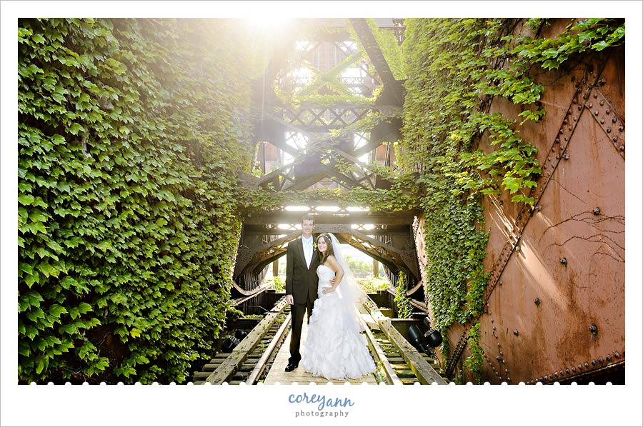 bride and groom on old iron bridge near shooters in cleveland ohio