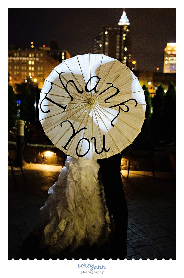 bride and groom silhouette with thank you umbrella