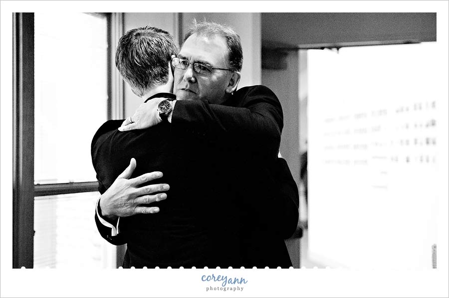 groom's father hugging groom at church in chesterland ohio