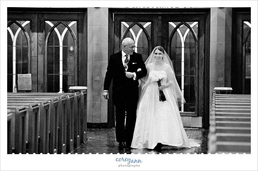 bride walking down aisle at st john the evangelist in cleveland