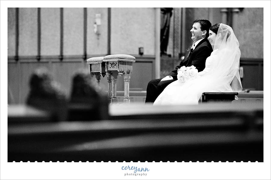 bride and groom during wedding ceremony at st john the evangelist in cleveland