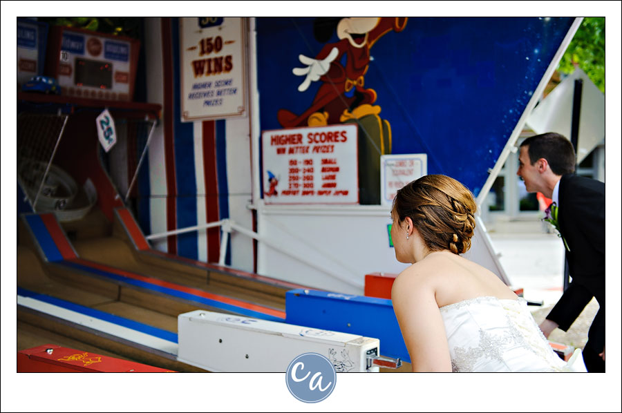 bride and groom playing skee ball