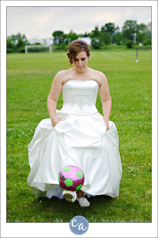 bride playing soccer in wedding dress