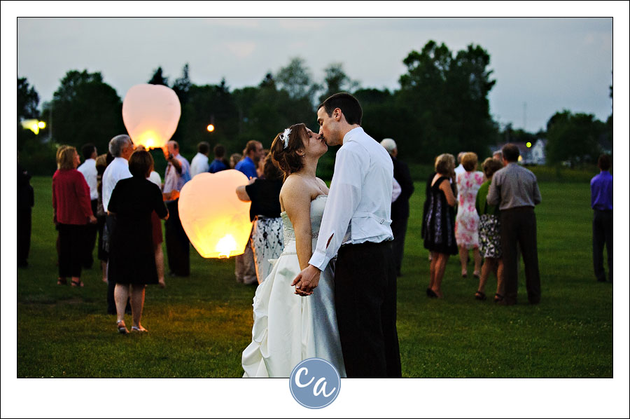 bride and groom kissing during wish lantern release