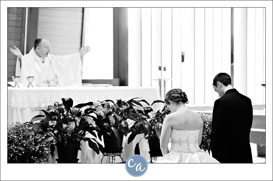 bride and groom during catholic ceremony