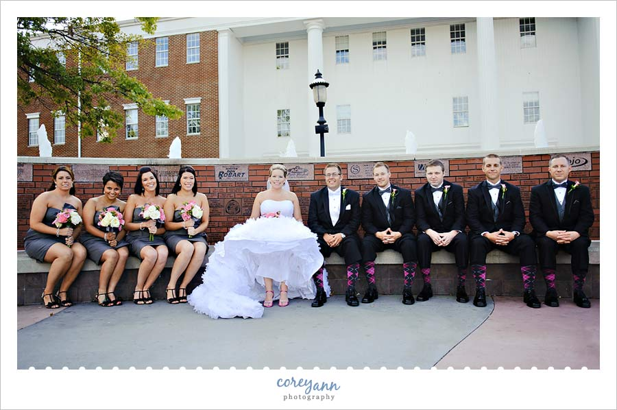 bridal party in pink and black with argyle socks