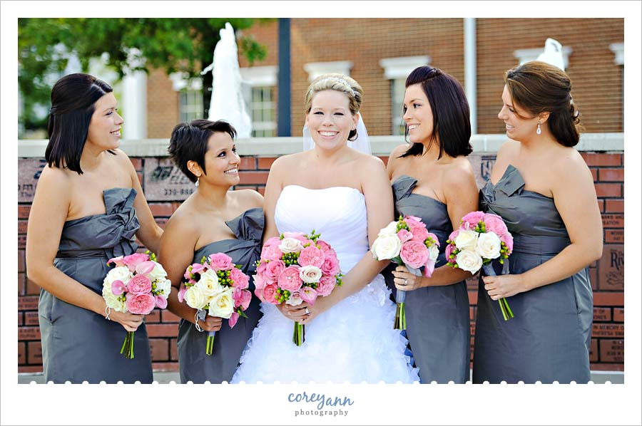 bride with bridesmaids in grey and pink
