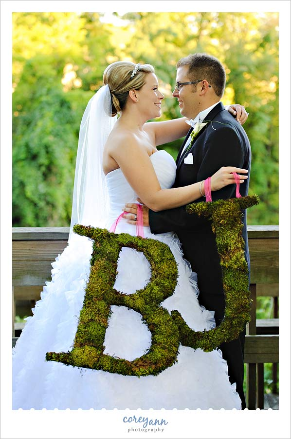 bride and groom with moss initals