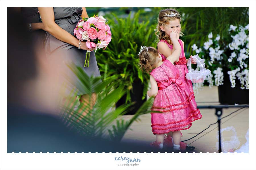 flower girl picking nose during ceremony
