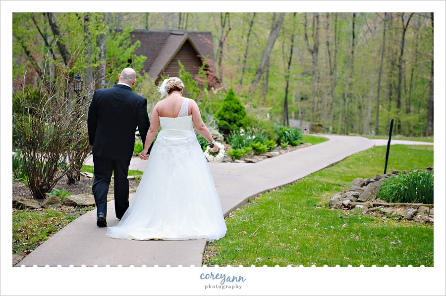 bride and groom walking the grounds at Landoll