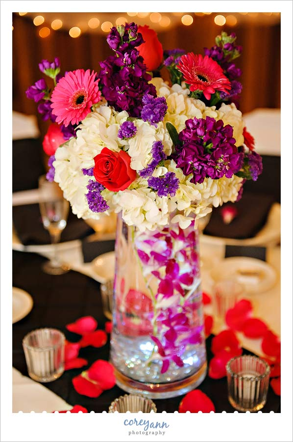 pink purple and white lit centerpiece from wedding at Landoll