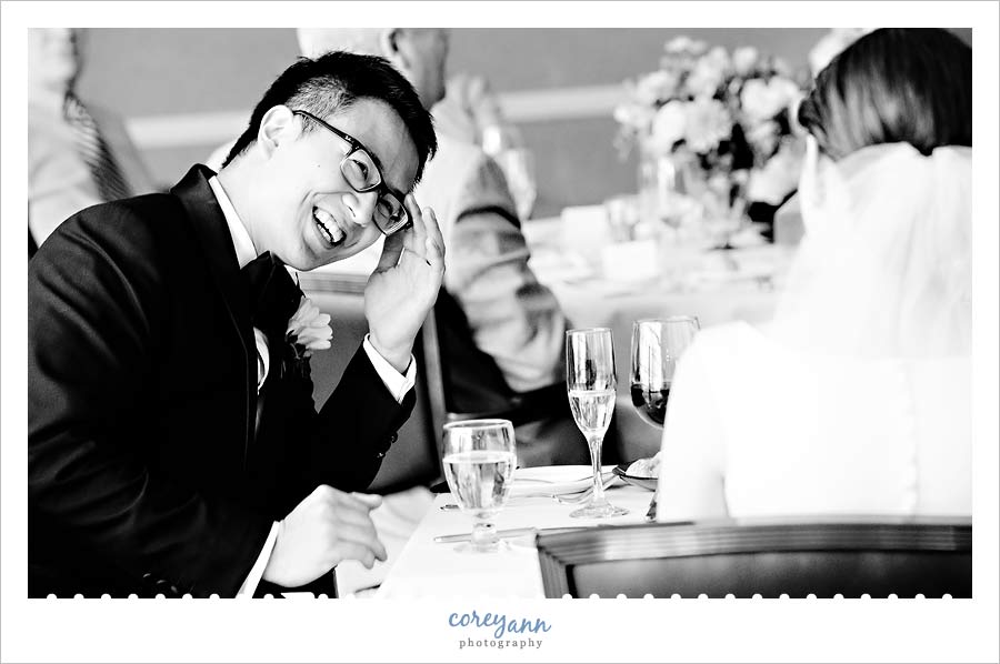 groom embarrassed during toast at wedding reception