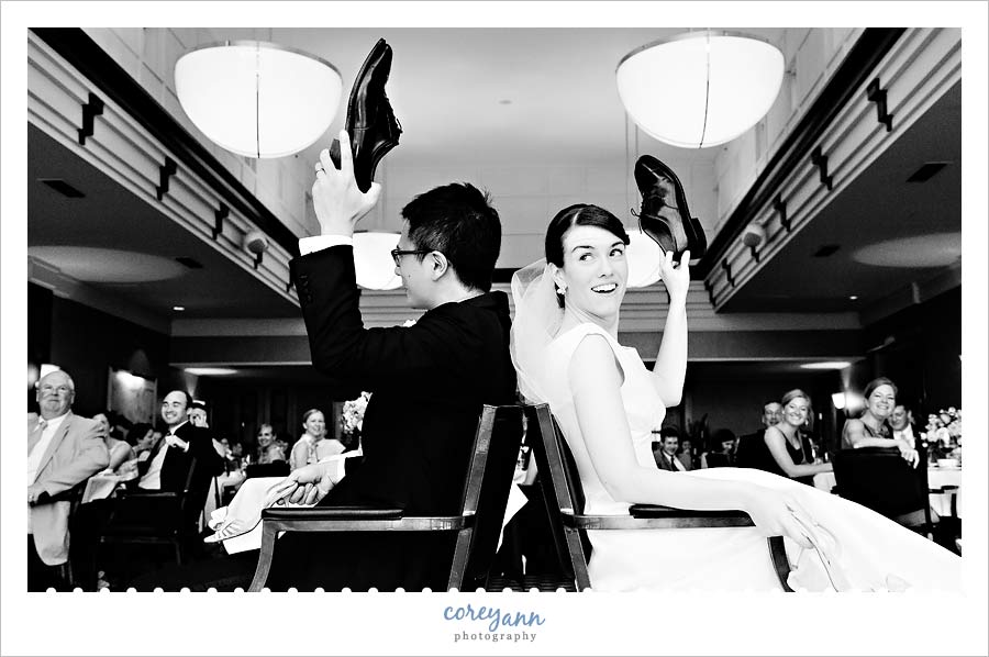 wedding shoe game during reception with bride and groom