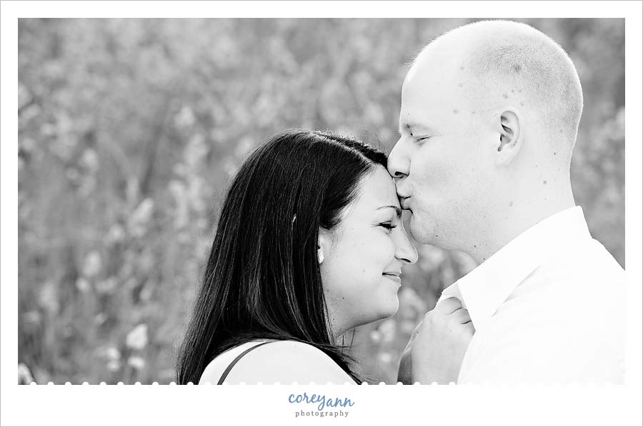 kissing forehead in engagement picture in ohio