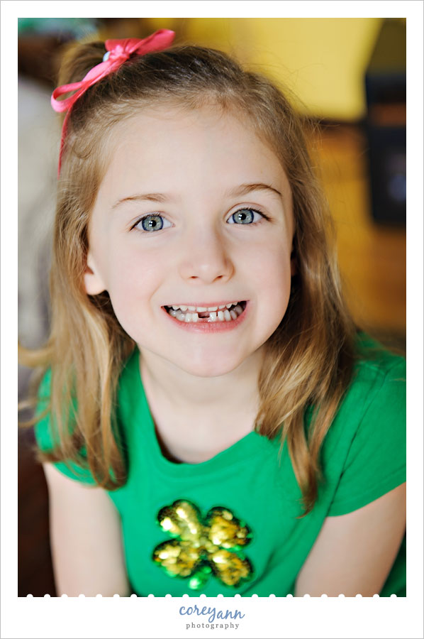 little girl with recently lost tooth