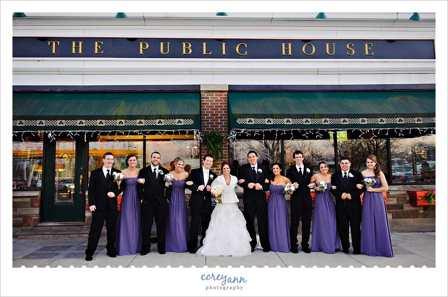 bridal party posing outside of the public house in cleveland ohio