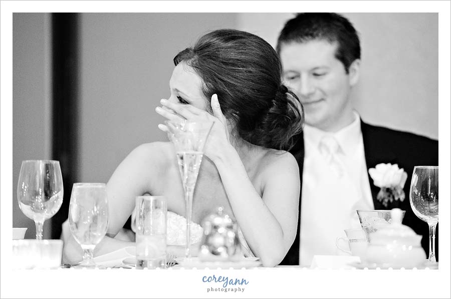 bride wiping a tear away during toasts at la centre in avon ohio