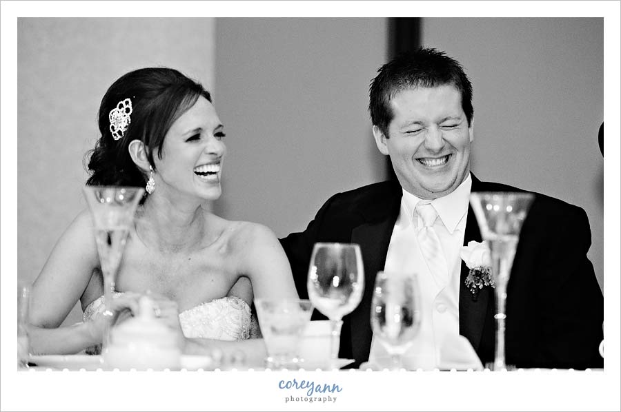 bride and groom laughing during best man