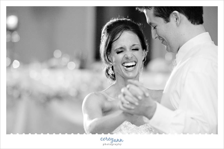 bride laughing during the first dance at reception