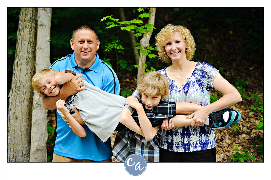 family pose with holding child in ohio
